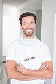 Germany, Dentist holding clip board, smiling, portrait