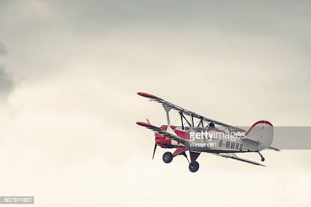 Germany, Dierdorf, Vintage biplane in the air