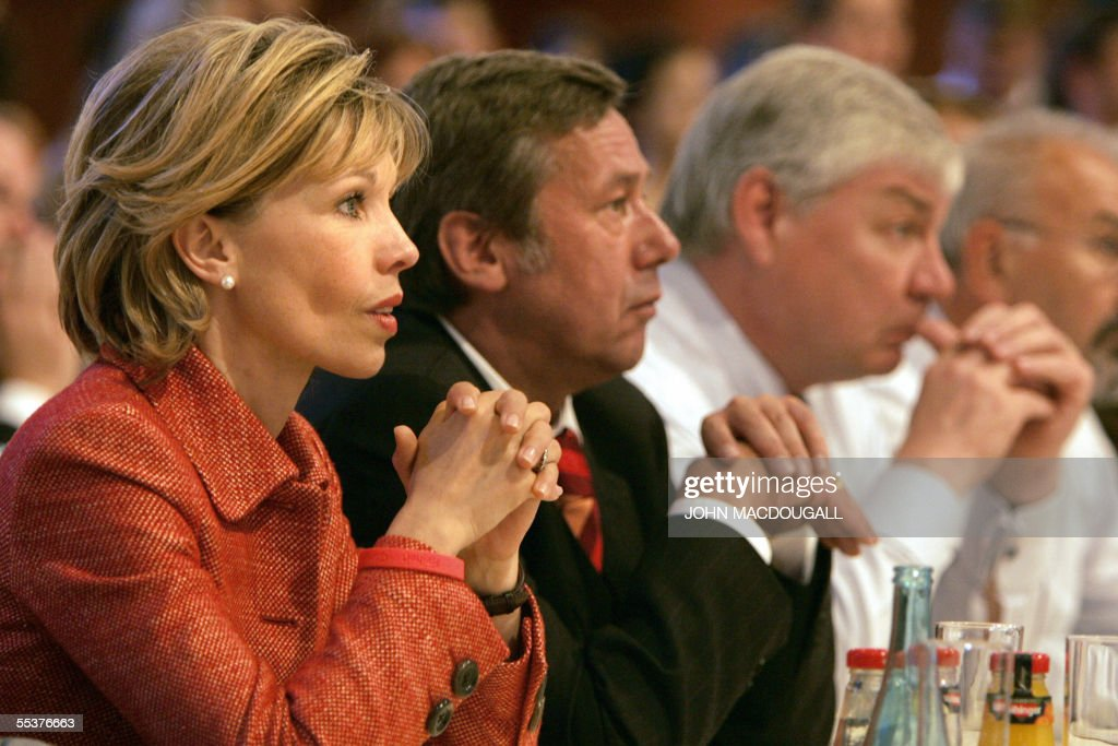 Doris Schroeder-Koepf (L), wife of German Chancellor Gerhard Schroeder, listens to her husband's speech as he addresses a Social Democratic Party (SPD) congress in Berlin 31 August 2005, ahead of general elections scheduled for 18 September. AFP PHOTO JOHN MACDOUGALL