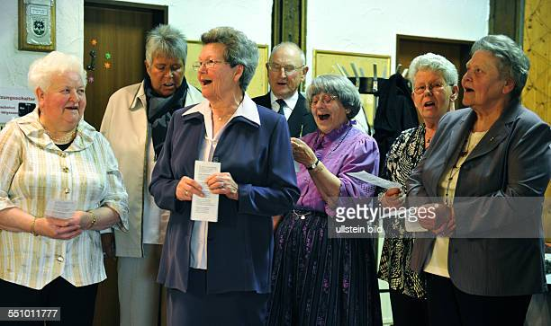 Merry seniors celebrate the Diamond Wedding of a couple in the church and barn with singing and Polonaise