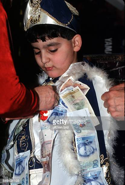DEU Germany Dortmund 1999 Turkish circumcision s ceremony money presents to the boy