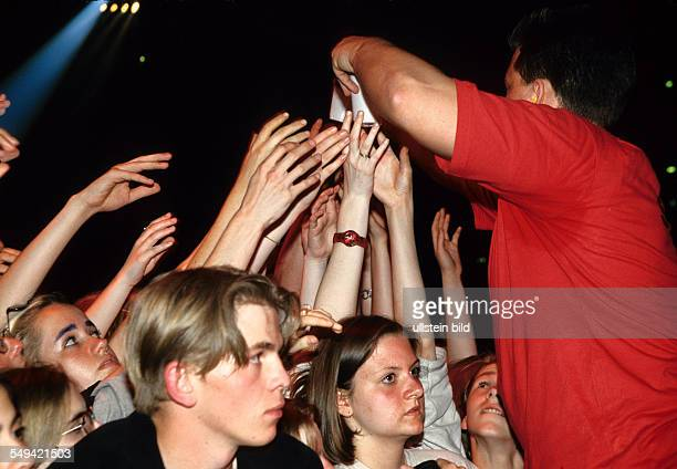 DEU Germany DortmundHoerde 1997 YOU 97 Eins Liveparty in Dortmunds Westfalenhalle security man giving water to the fanatics