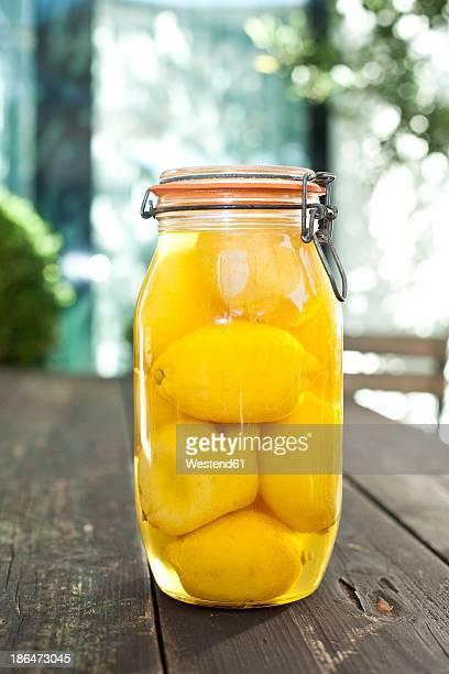 Germany, Duesseldorf, Lemon pickles in glass of jar