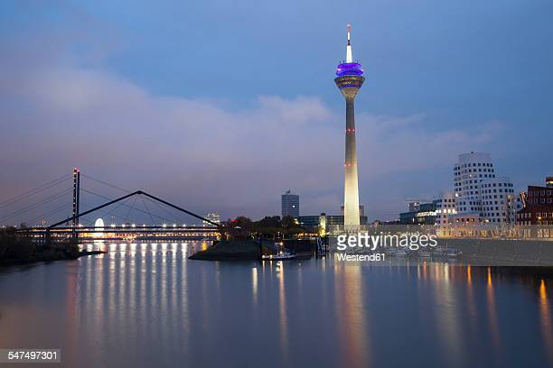 Germany, Duesseldorf, media harbor with Rhine Tower at dusk