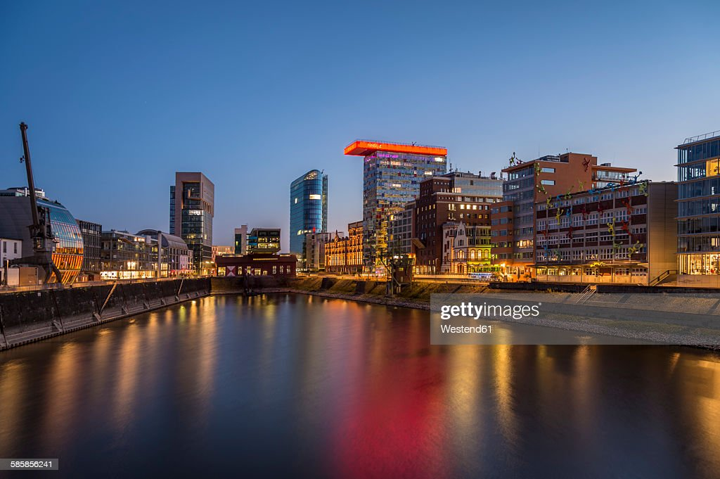 Germany, Duesseldorf, Media harbour, High-rise building Colorium, blue hour