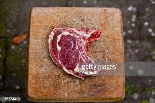 Germany, Duesseldorf, Raw beef on wood block