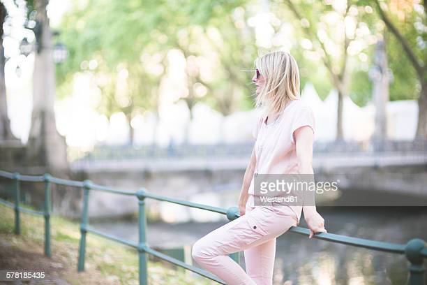 Germany, Duesseldorf, woman waiting at Koenigsallee