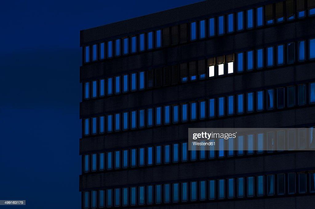 Germany, Dusseldorf, Lighted windows in office building