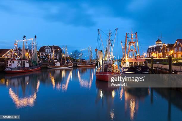 Germany, East Frisia, Neuharlingersiel, Christmas illumination at the harbour