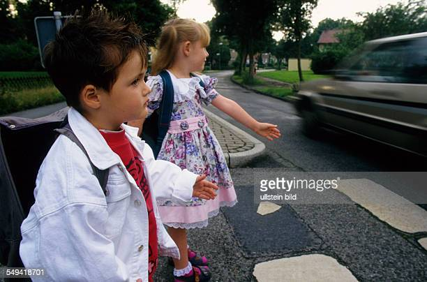 Primary pupils and the road traffic at a zebra crossing