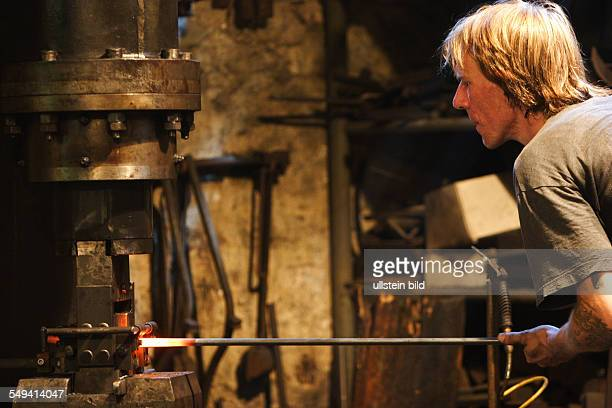 Workshop for metal processing of Michael Stratmann An apprentice at the hearth