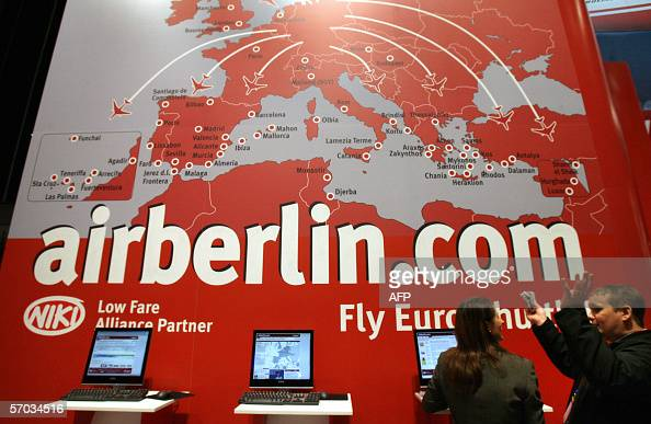 Fair goers stand at the booth of German budget airline Air Berlin 09 March 2006 at the 'International Tourism Fair' in Berlin The company has...