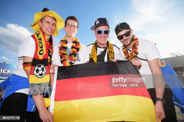 Germany fans pose for a photo with a Germany flag outside the stadium prior to the UEFA European Under21 Championship Final between Germany and Spain...