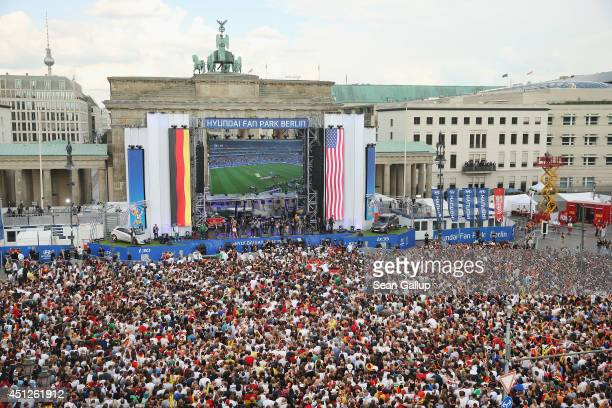 Germany fans watch the GermanyUSA World Cup match at the Hyundai Fan Park public viewing in front of the Brandenburg Gate in Tiergarten park on June...