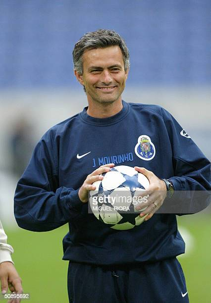 FCPorto coach Jose Mourinho smiles during a training session 25 May 2004 in the Arena AufSchalke stadium in the western town of Gelsenkirchen one day...