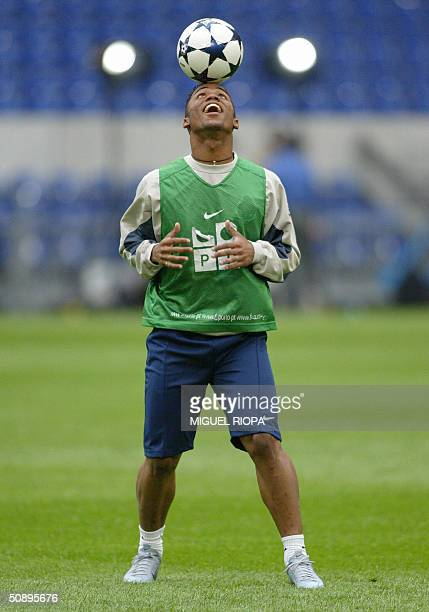 FCPorto player Brazilian midfieder Carlos Alberto heads off the ball during a training session 25 May 2004 in the Arena AufSchalke stadium in the...