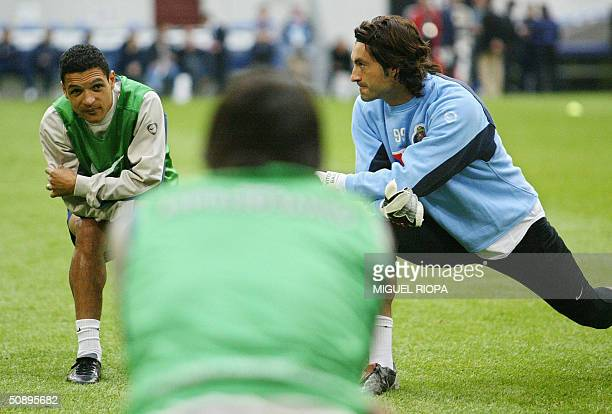 FCPorto players Brazilian forward Derlei and goalkeeper Vitor Baia stretch during a training session 25 May 2004 in the Arena AufSchalke stadium in...