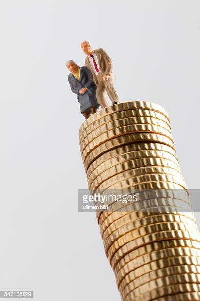 Germany figures of an elder couple on a pile of cent coins