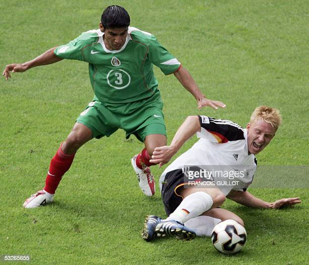 FILES A file picture taken on 29 June 2005 shows Mexican defender Carlos Salcido and Gerrman forward Mike Hanke during the Confederations Cup third...