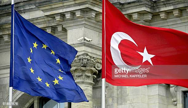 FILES Picture taken 16 June 2004 shows the Turkish flag floating next to the European in front of the Reichstag hosting the lower house of the German...