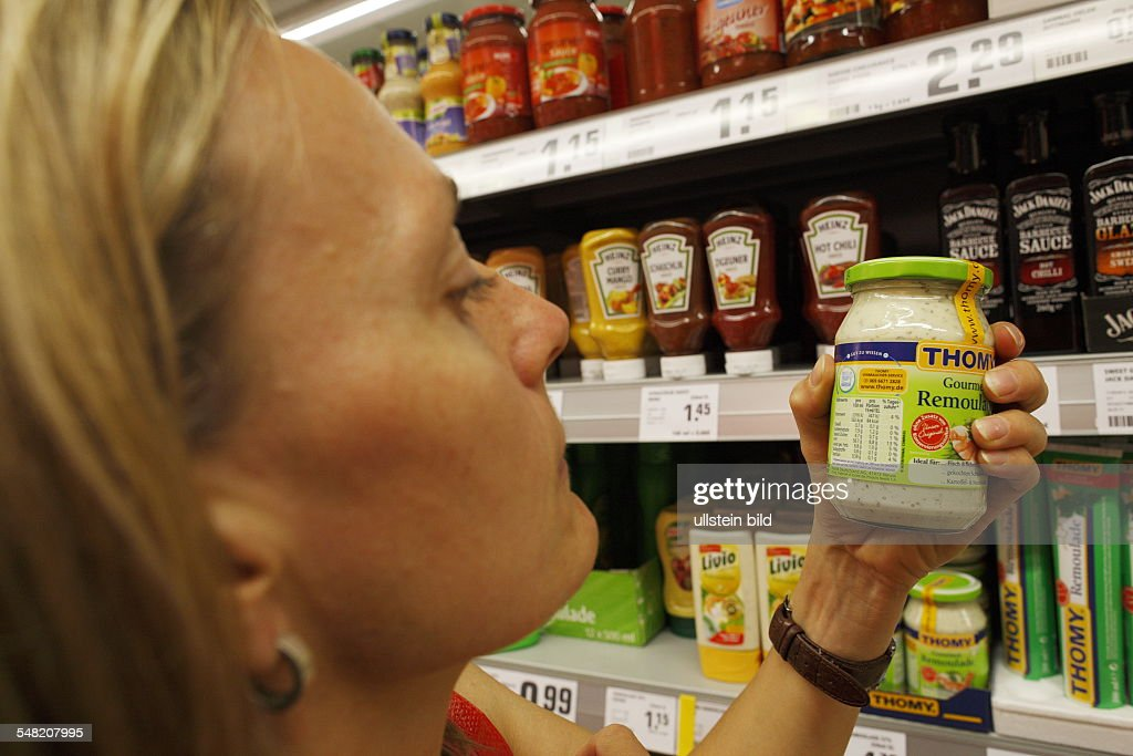 Germany food labeling customer is reading the information on a glass with remoulade