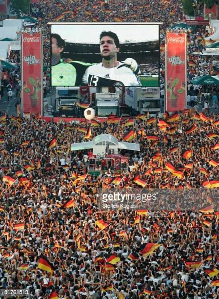 Germany football fans wave with flags while watching the UEFA EURO 2008 final match between Germany and Spain at the Fan Mile public viewing area in...