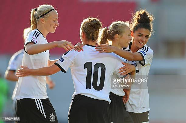 Germany forward Pauline Bremer celebrates the second germany goal with scorer Linda Dallmann and Theresa Panfil and Manjou Wilde during the UEFA...