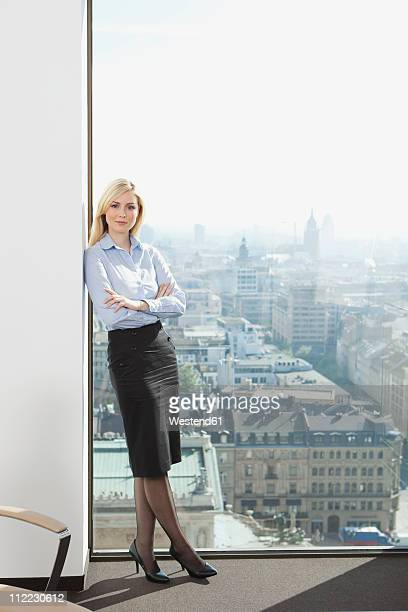 Germany, Frankfurt, Business woman with arms crossed, portrait