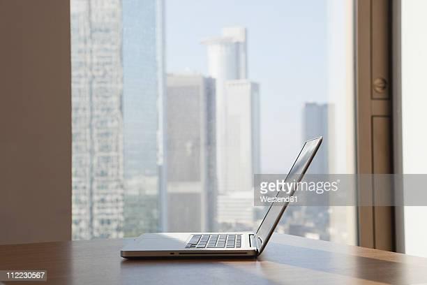 Germany, Frankfurt, Laptop on table in office
