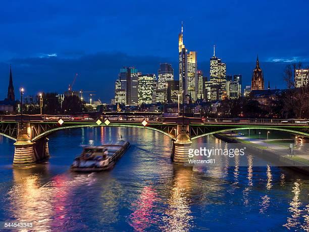 Germany, Frankfurt, River Main with Ignatz Bubis Bridge, skyline of finanial district in background