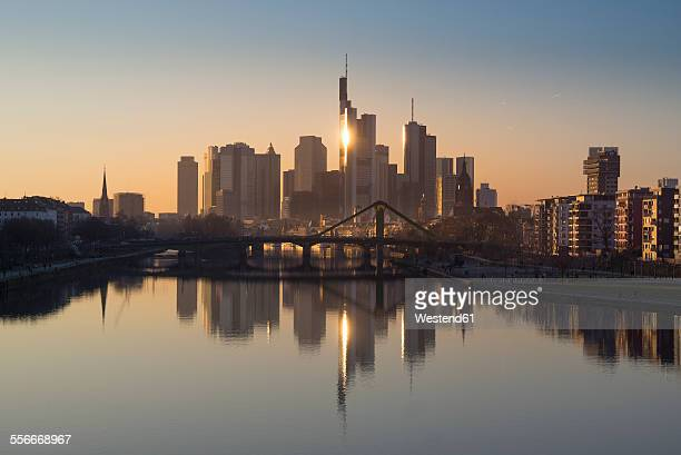 Germany, Frankfurt, skyline with water reflection at Main River in the foreground