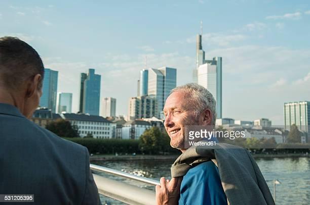 Germany, Frankfurt, two businessmen on bridge