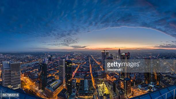 Germany, Frankfurt, View over the lighted city at sunset from above