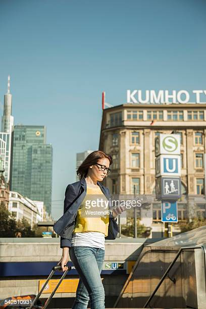 Germany, Frankfurt, young businesswoman on the move in city center