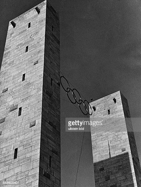 Germany Free State Prussia Berlin Berlin The Olympic Rings hanging between two towers on the Mai Feld at the Reichssportfeld ca 1936 Photographer...
