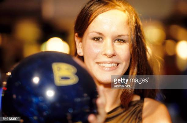 Free time Portrait of a young woman bowling