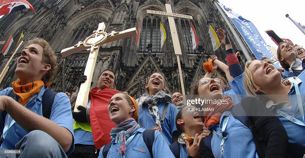 French pilgrims of the World Youth Day wave with crosses in front of Cologne's Cathedral on 15 August 2005, one day before the launch of the World Youth Day. The event will culminate in an open-air Mass led by the Pope Benedict XVI on 21 August at Marienfeld, a former open-pit coal mine.