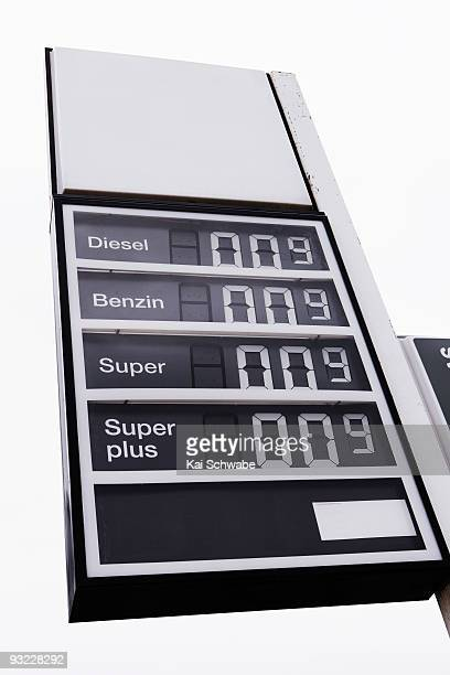 Germany, Gas station with price board, low angle view