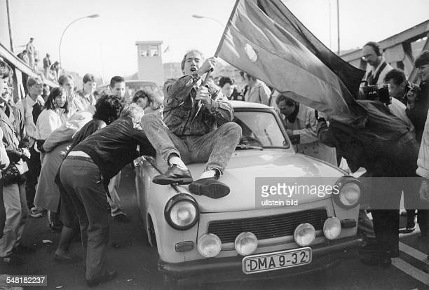 Germany / GDR Berlin The fall of the wall A Trabi car crossing the border at the Bornholm Bridge in Wedding