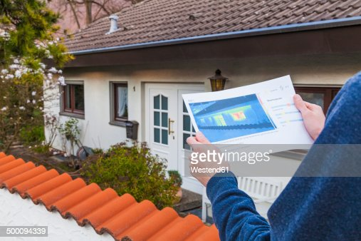 Germany, Geislingen, Person holding thermography of building