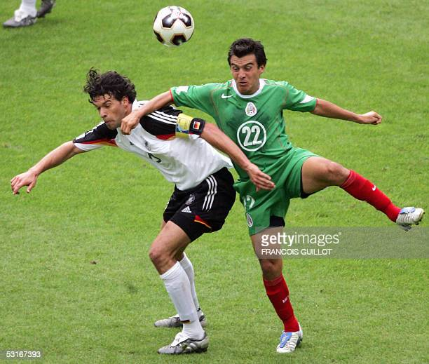 German midfielder Michael Ballack vies with Mexican midfielder Luis Perez during the Confederations cup third place final football match Germany vs...