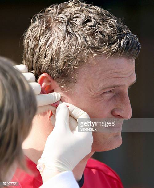 German national team player Robert Huth has some blood drawn from his ear during medical and performance tests in Duesseldorf 24 April 2006 ahead of...