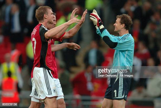 Germany goalkeeper Jens Lehmann celebrates with team mate Per Mertesacker after the final whistle