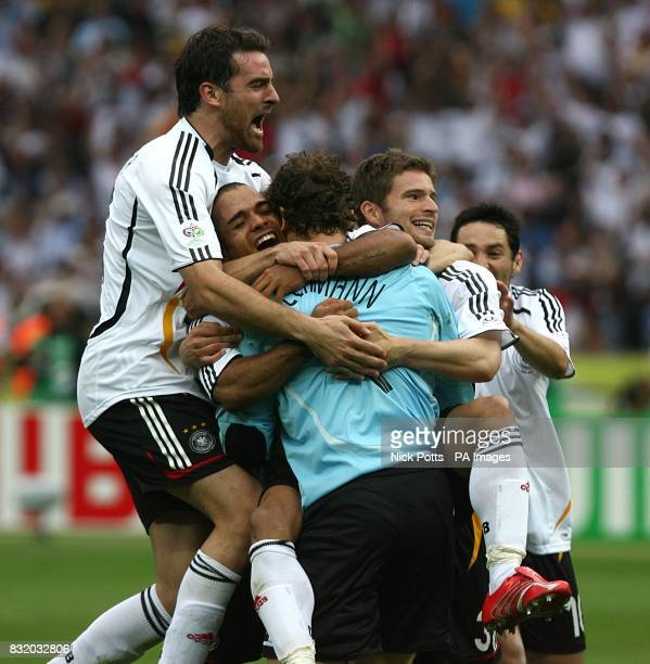 Germany goalkeeper Jens Lehmann is congratulated after securing victory over Argentina