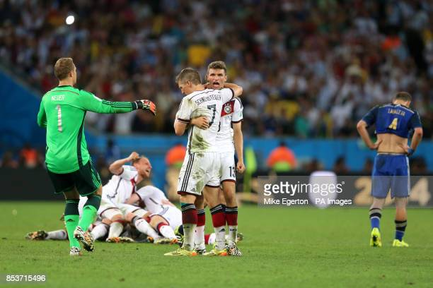 Germany goalkeeper Manuel Neuer celebrates at the final whistle with teammates Bastian Schweinsteiger and Thomas Muller