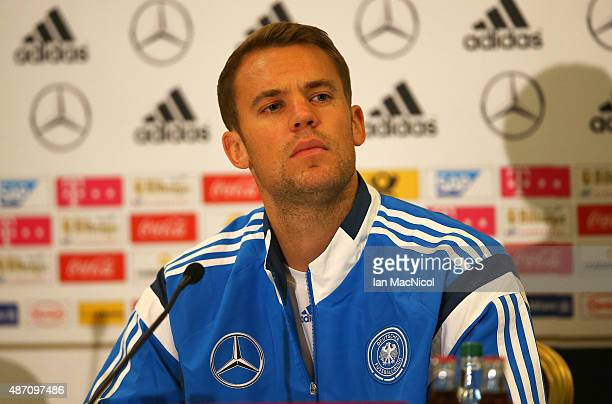 Germany goalkeeper Manuel Neuer looks on during a press conference ahead of their UEFA Euro 2016 qualifier against Scotland at Hampden Park on...
