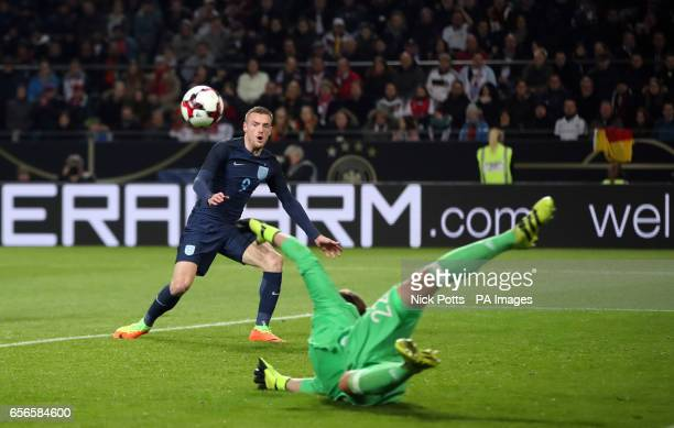 Germany goalkeeper MarcAndre ter Stegen makes a save as England's Jamie Vardy looks on during the International Friendly match at Signal Iduna Park...