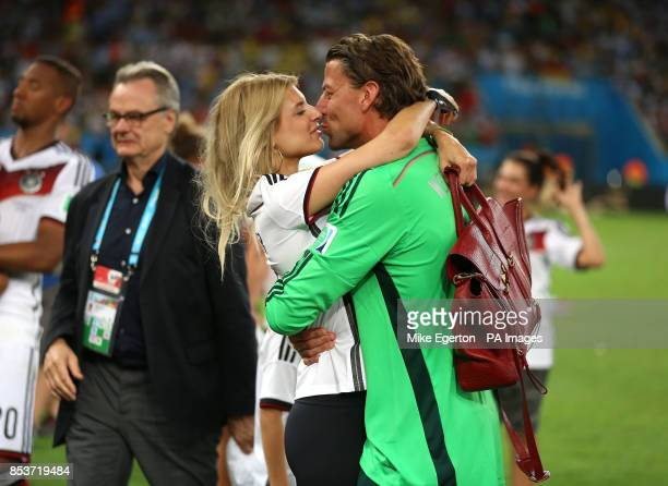 Germany goalkeeper Roman Weidenfeller and his girlfriend Lisa Rossenbach celebrate victory with a kiss