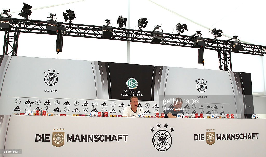 Germany goalkeeping coach Andreas Kopke (L) speaks to the media during a press conference at the German national team's pre-EURO 2016 training camp on May 27, 2016 in Ascona, Switzerland.