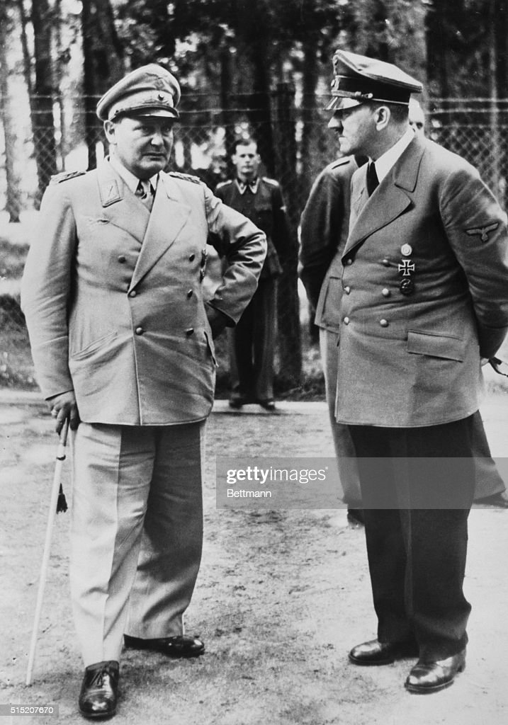 Grim moment for Hitler. A Hoffman photo of the attempted bombing of Hitler at this field headquarters on July 20, 1944 shows a grim Fuehrer and Goering talking it over two hours after the blast. The photo was personally banned for publication by Hitler because of the facial expressions.